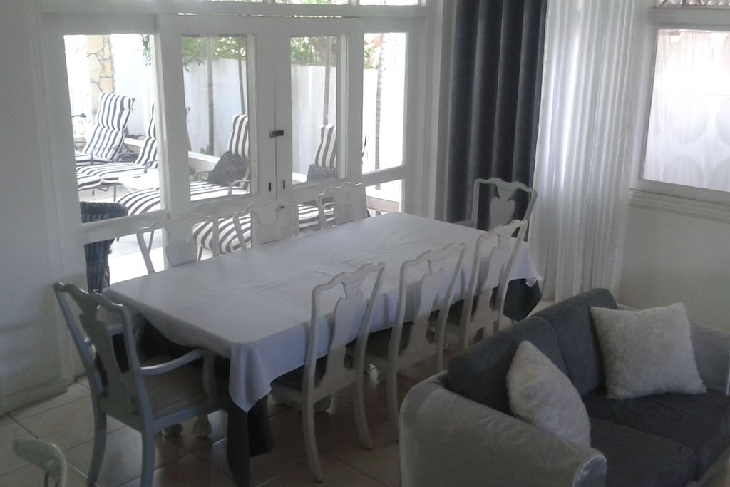 Dinning room table that leads to the outside lounge