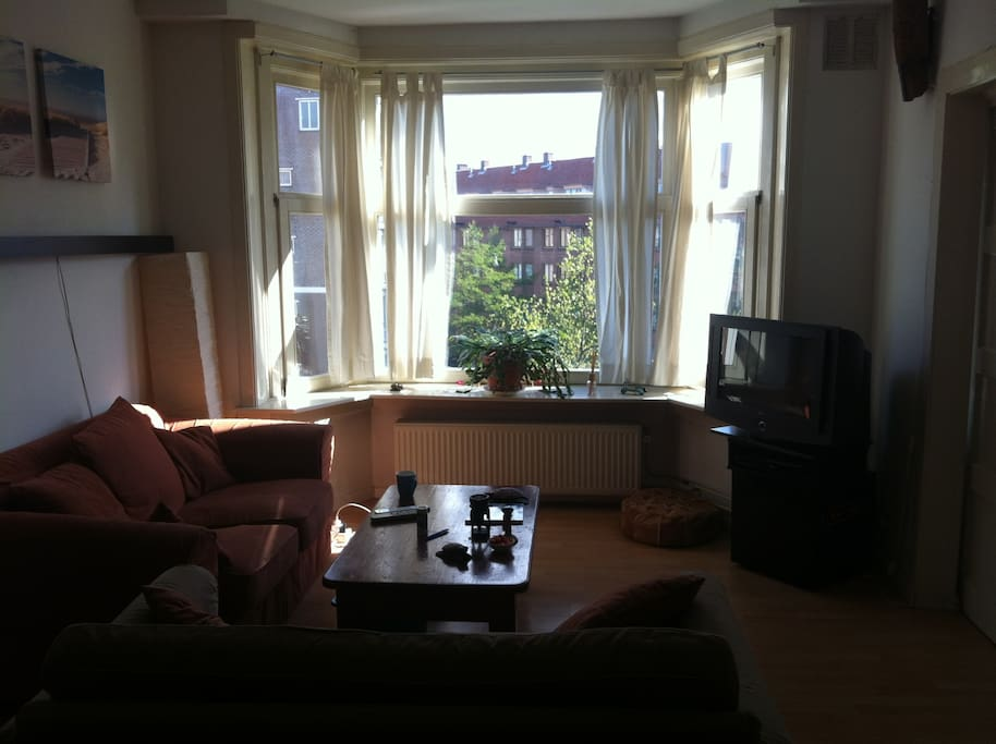 Living room with television and sun during the morning