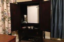 Mini-fridge and coffeemaker in bedroom