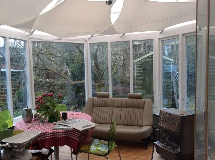 Modern light breakfast room overlooking the colourful spacious garden, south facing