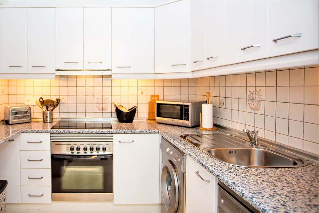 An excellently resourced kitchen, with cooker, microwave, hob, washer, dishwasher and fridge/freezer!