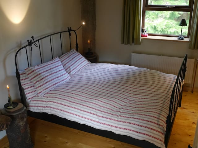 Bedroom ensuite. Kingsize bed with a comfortable mattress and a 10 Tog goose down duvet