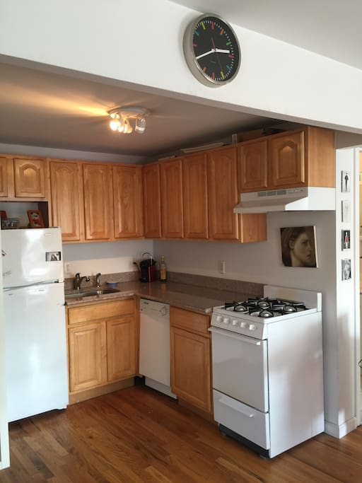 Spacious kitchen with dishwasher and gas stove