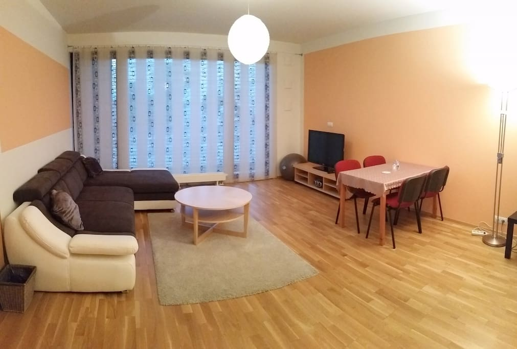 Living room with extended sofa (Flat screen upon request)