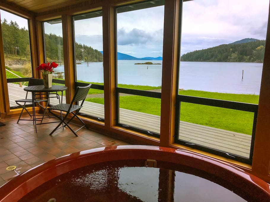 Enjoy the view from the hot tub in the sun room, where you can watch the birds and sea animals during the day or see the twinkling lights of Anacortes and the stars on a clear night.