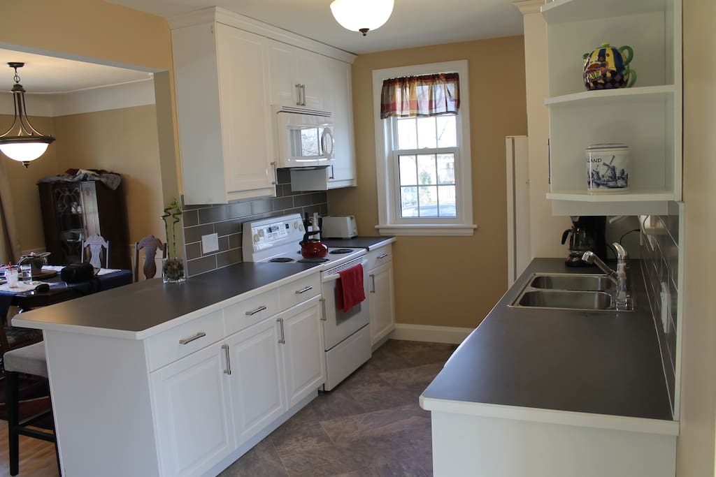 Brand new kitchen includes dishwasher, microwave, toaster, coffee maker, etc