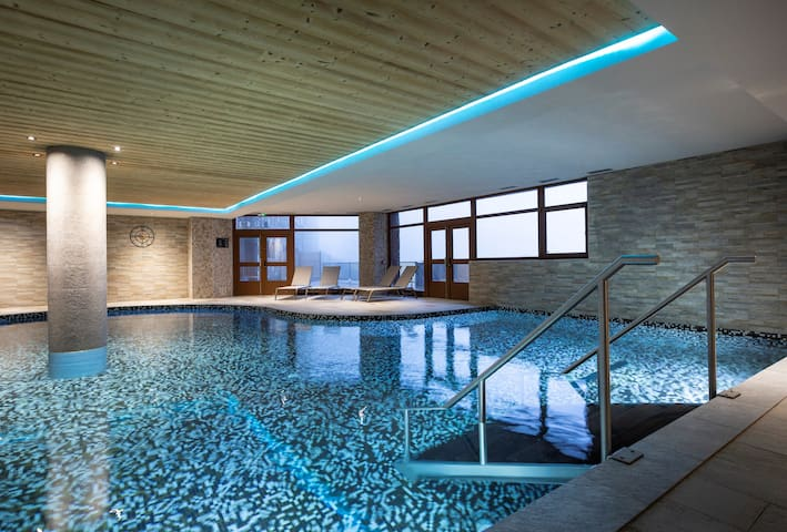 The shared indoor pool is heated and perfect for splashing around!