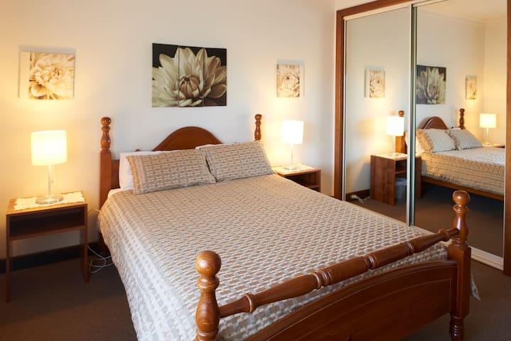The main bedroom has a queen bed and en suite