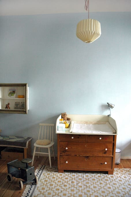 Bedroom 2: Children-friendly with toys, changing table and crib...