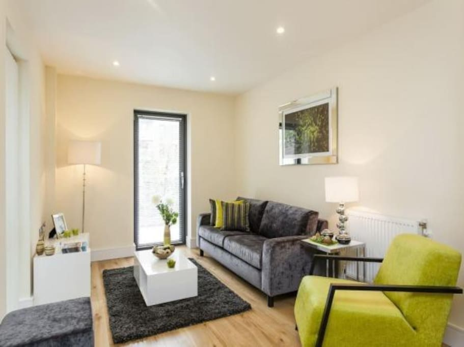 Living room with door to balcony