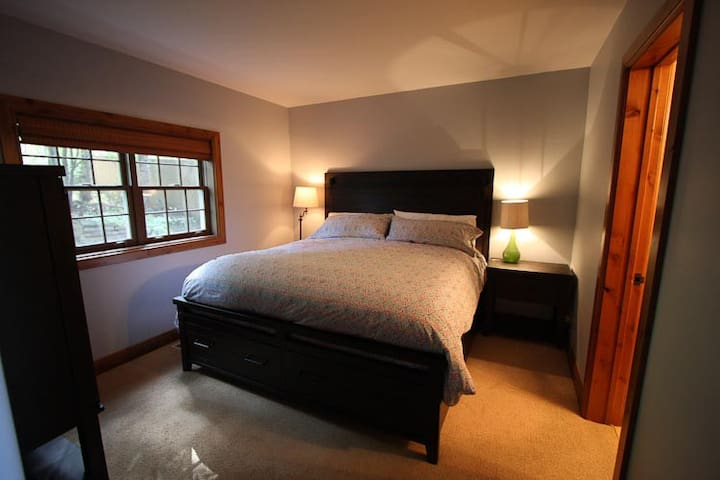 Master suite #2 with King bed, closet and a chest of drawers