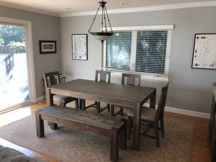 Modern, yet warm dining area with seating for 7.