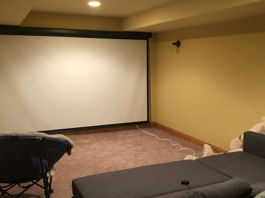 """135"""" Media Room with 7.2 Surround sound and sofa bed"""