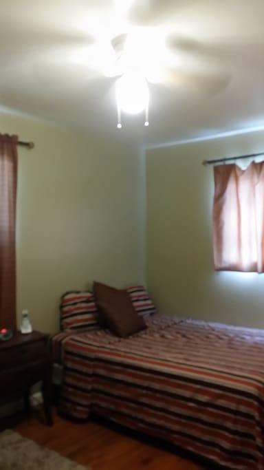Ceiling Fan/ Windows/ Queen Bed/Nightstand /Lamp & Alarm Clock