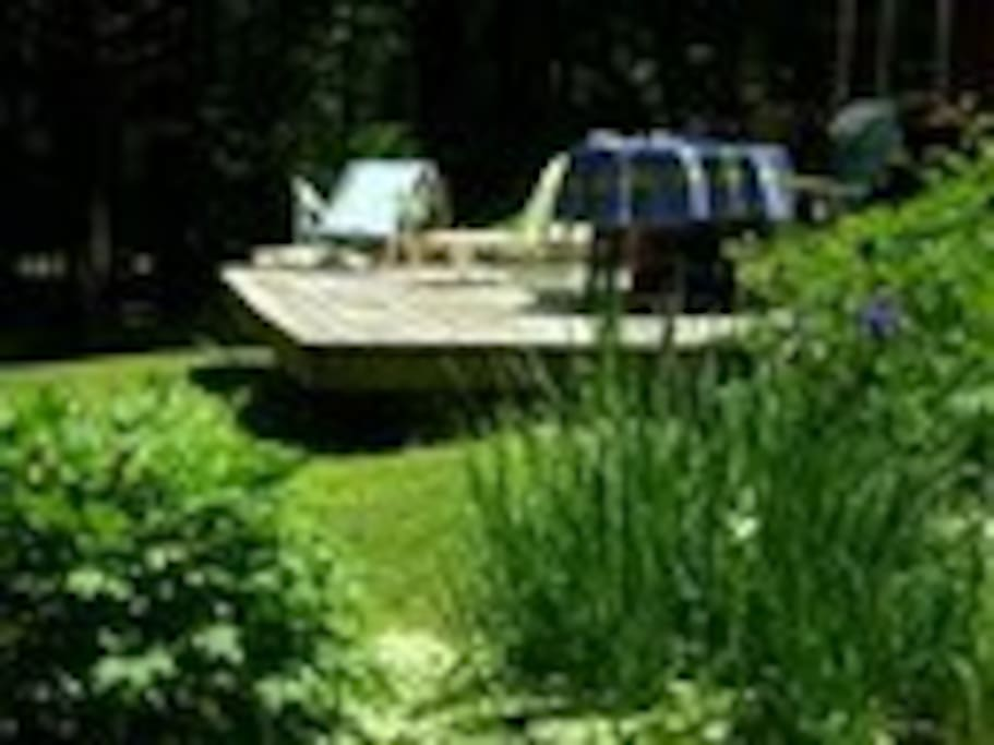 Back view of house -- sun deck taken from summer's blooming multiple perennial gardens.