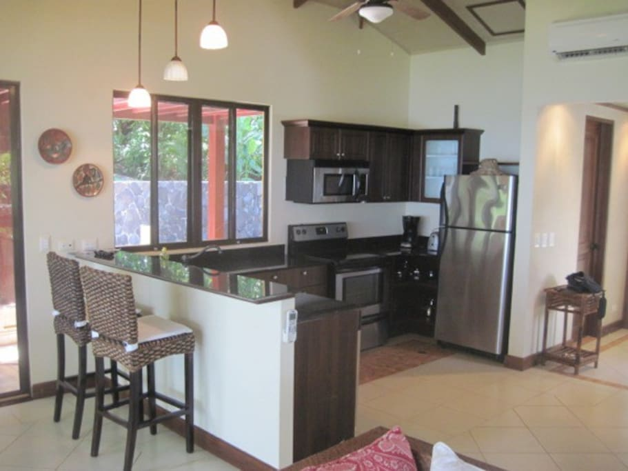 Full Kitchen and covered patio to enjoy your meals