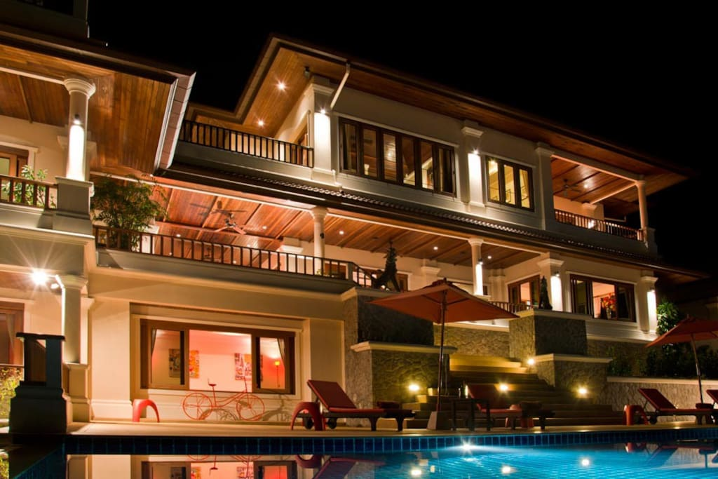 Night time view of villa and pool