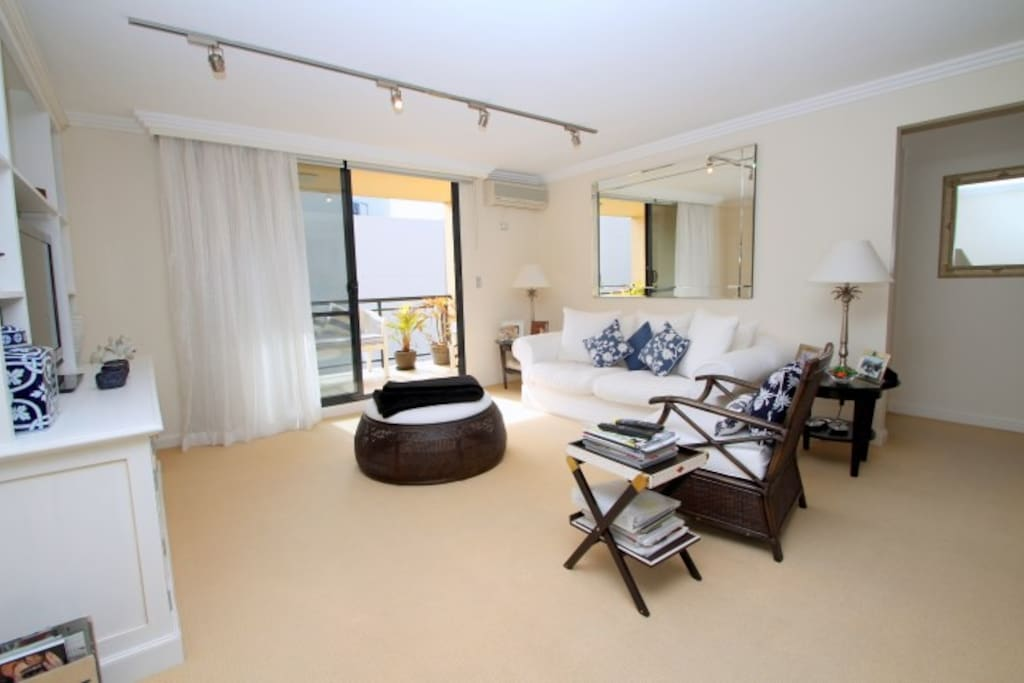 Oversized north-facing living space with air conditioning and large LCD TV with Pay TV