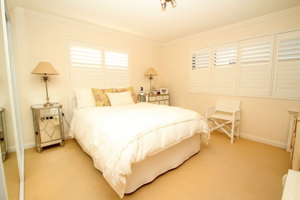 Master bedroom with large built-in wardrobe and ensuite