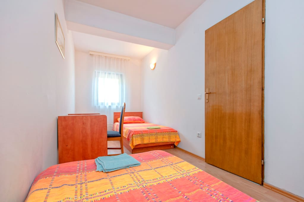 room with two single beds