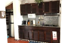 The kitchen includes a refrigerator/freezer, microwave, stove, Oster counter-top oven and coffee maker.