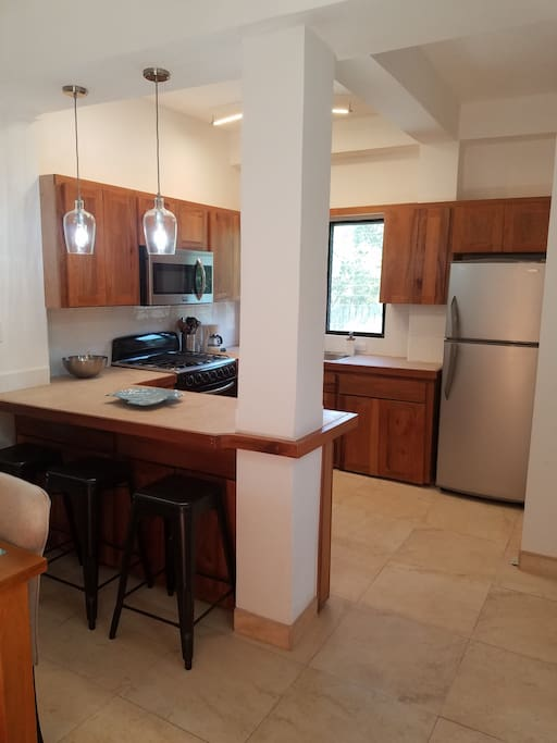 Large kitchen with seating at the island and full size appliances...