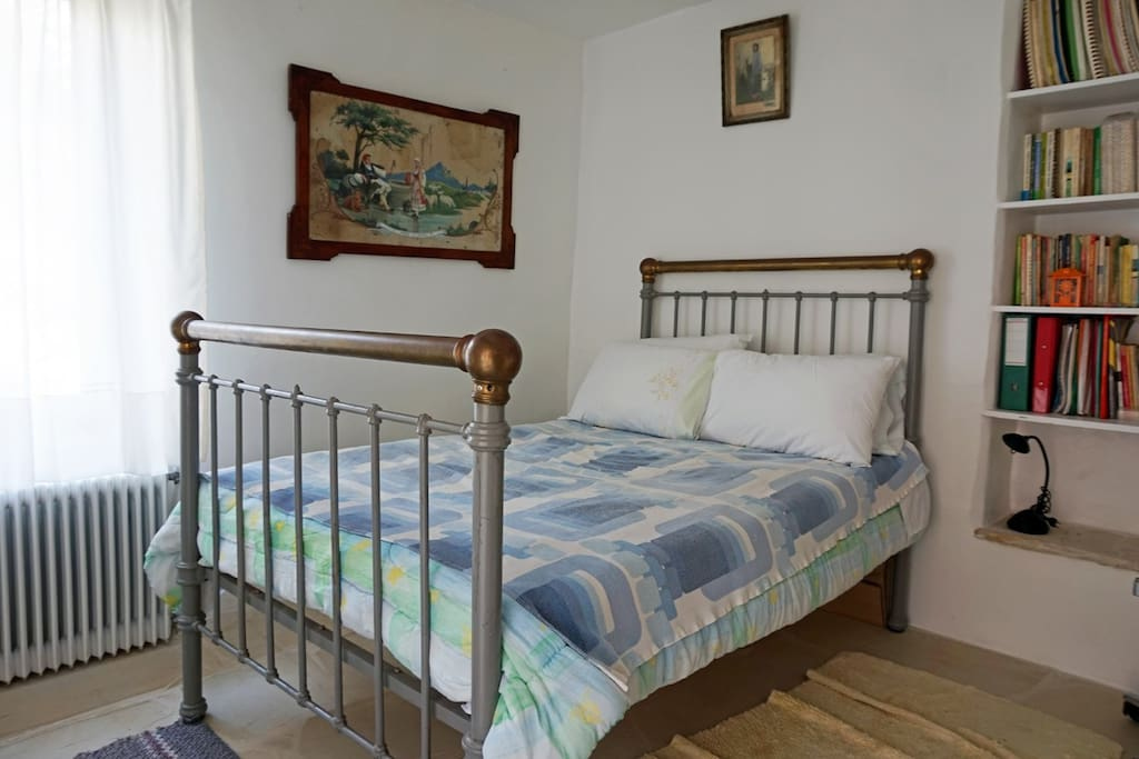 The spacious bedroom offers a double bed as well as a fitted bookcase.