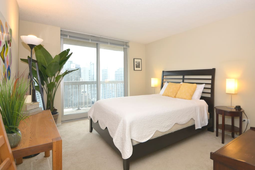 Spacious master suite with ensuite bathroom and direct access to balcony