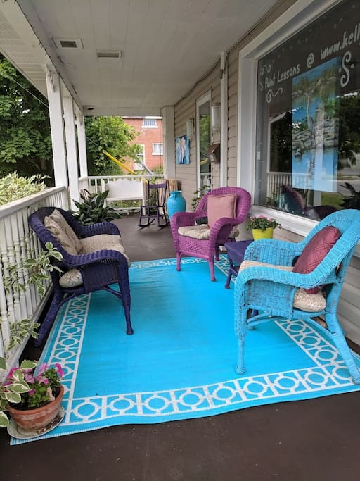 Fun Artsy front porch to relax on!