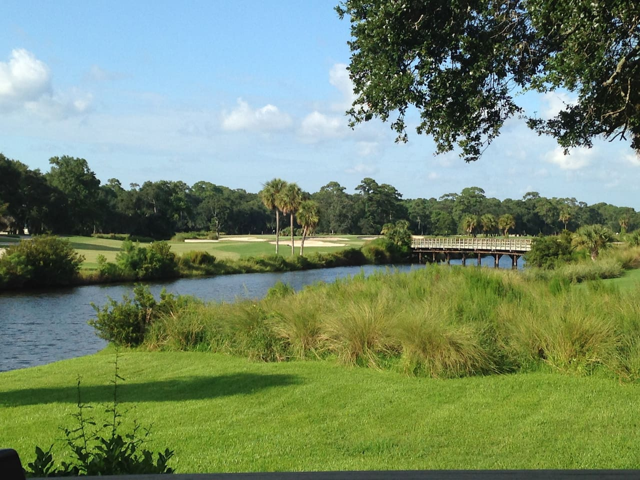 Stunning views of the lagoon and the signature 7th hole of the Fazio golf course from the back deck.