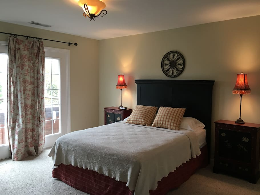 Master bedroom with private access to deck and hot tub, as well as personal TV