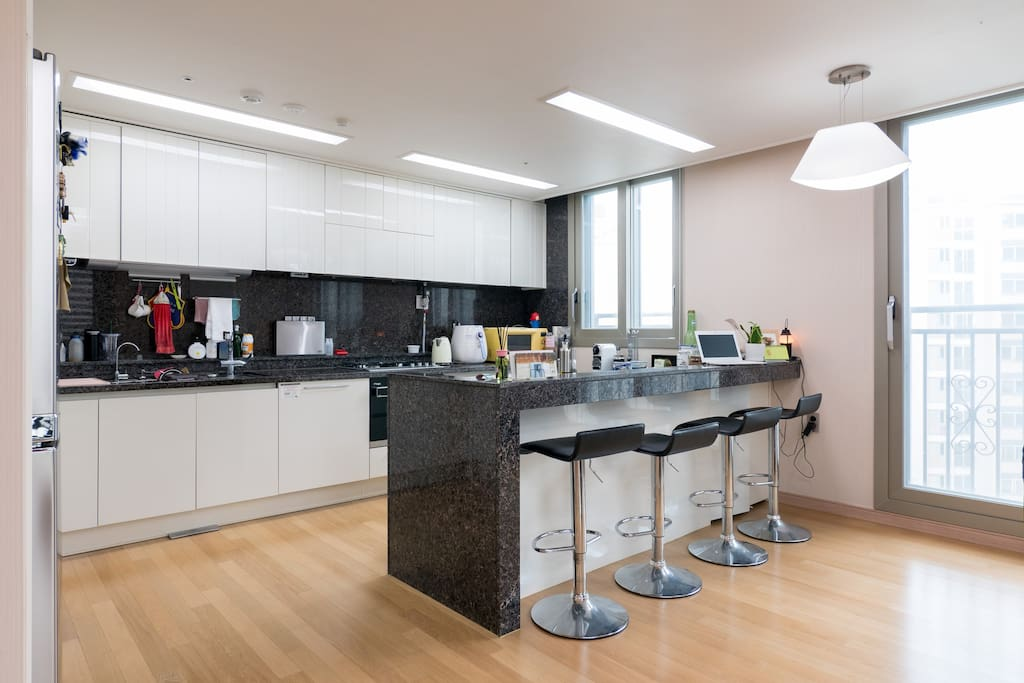 The kitchen area is huge for a big family or a large group of people. We used to invite our friends to enjoy cooking quality foods. All ingredients are easily purchased near the supermarket around the apartment complex.