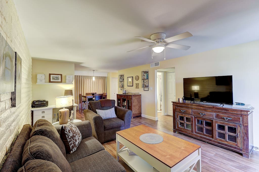 Living room with large flat screen TV.  Antenna  plus a Chromecast to stream your favorite entertainment and music.