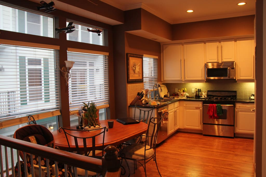 Kitchen/dining area with stainless steel appliances.