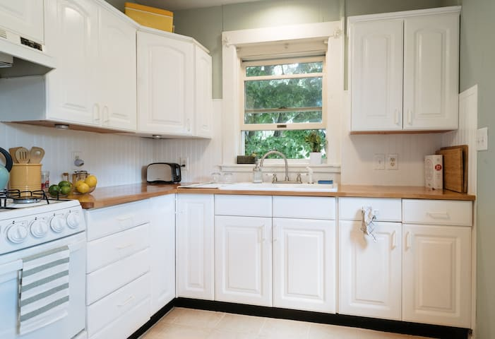Fully stocked kitchen has been recently updated with butcher block counters and a breakfast nook.