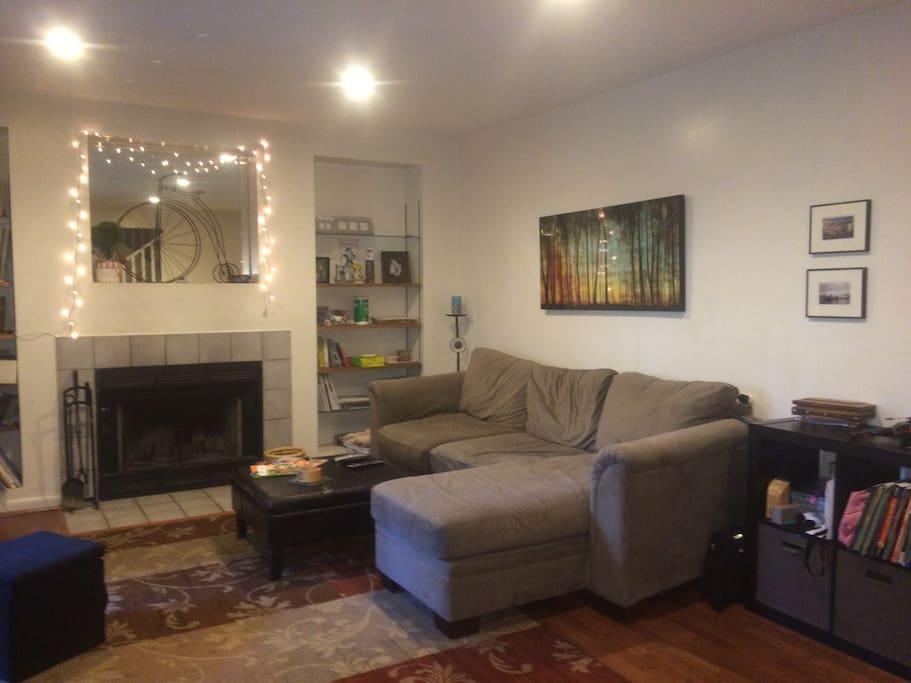 Comfortable Living Room with Plush Sofa + Large Flatscreen TV