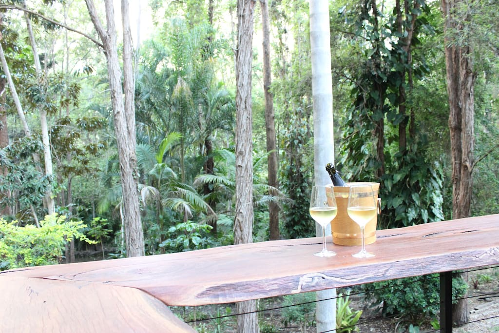 Unwind on the deck at the natural timber bar and enjoy nature surround you