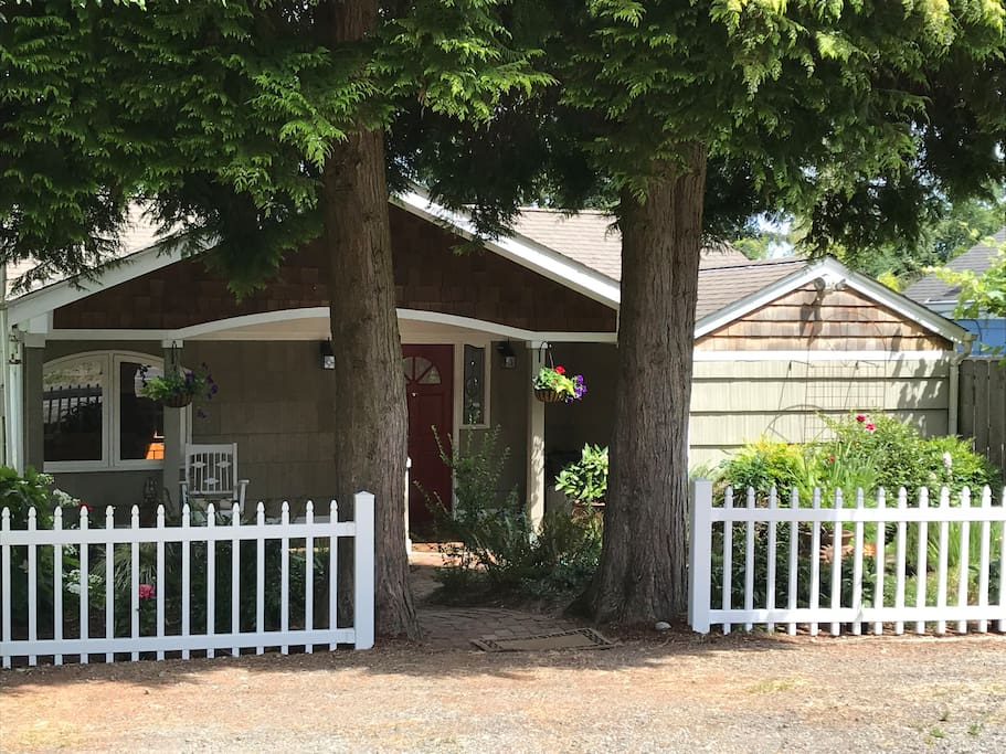 Twin cedar trees welcome you to the home.