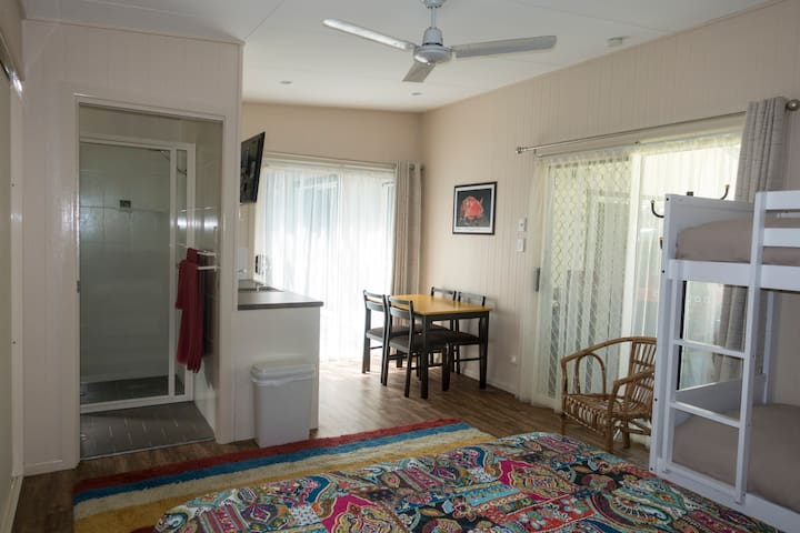 Self contained studio apartment with bathroom and kitchenette