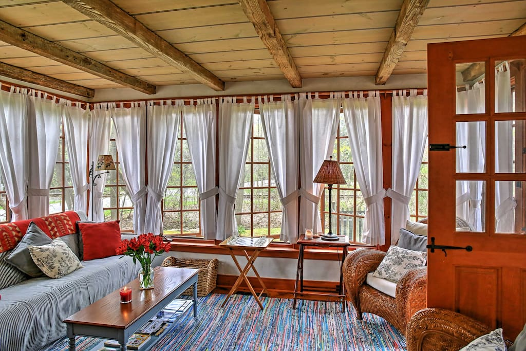 You'll love reading a favorite book from this sun porch as natural light streams through.