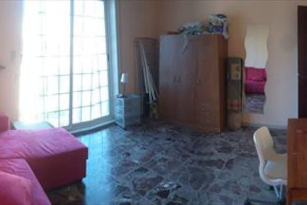 The room is spacious, has two huge closets, one wall, and a double window that lets in lots of light