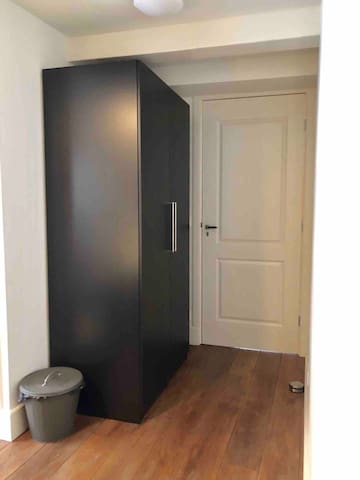 A big closet where you can store your clothes and suitcase. There is also a hairdryer in there!