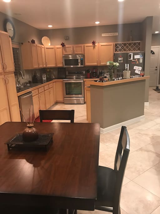 Shared kitchen, dinner table seats 4 people.