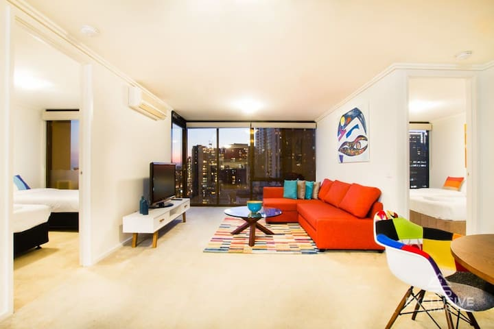 Spacious living room with modern furniture, plenty of seating, HDTV and more!