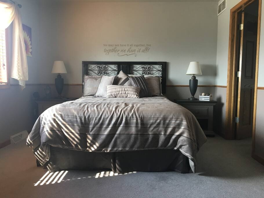 """""""The Bagger"""" features a Queen size bed in a spacious room. Plenty of light from the windows or the bedside lamps."""