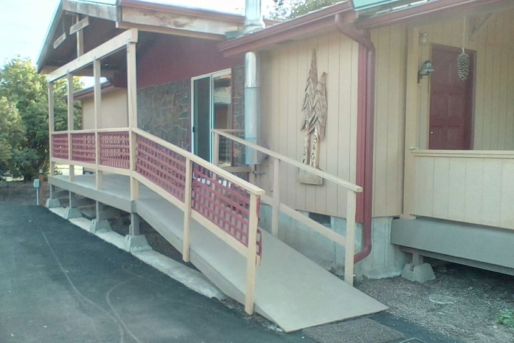 Easy ramp access to side covered porch. Ample parking in front.