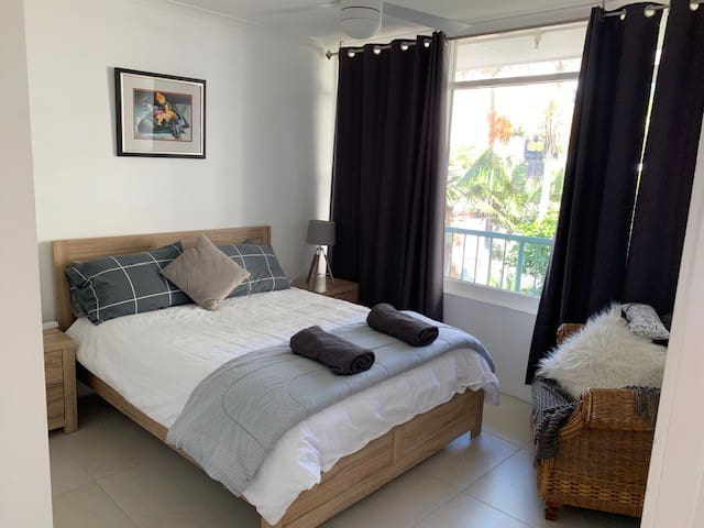 Light airy main bedroom