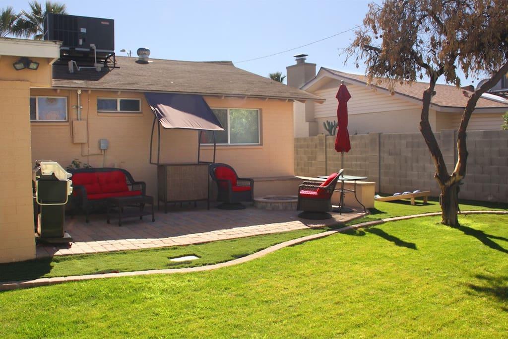 lush grass backyard w citrus trees & patio seating w umbrella for backyard dining + BBQ