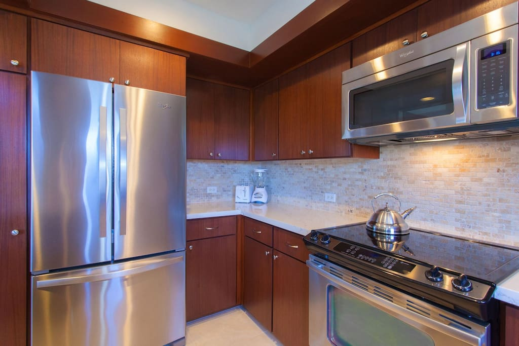 Kitchen features all stainless steel appliances.