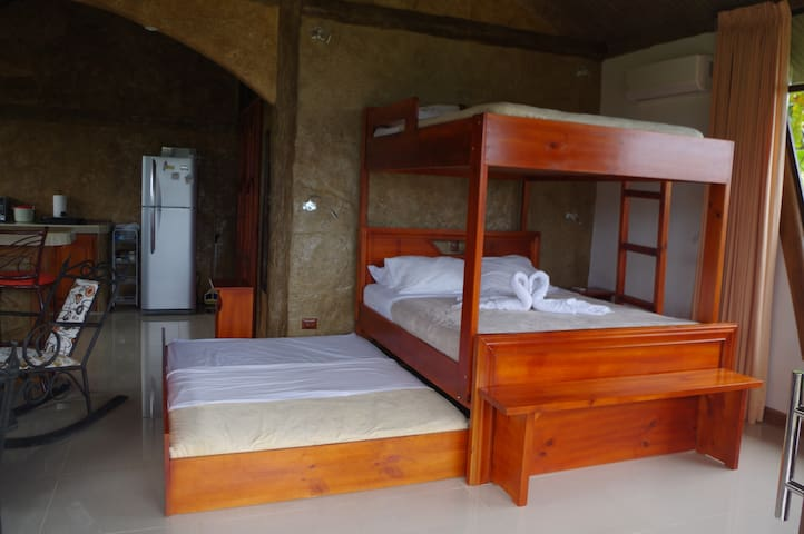 The studio apartment features a bunk bed and a pull out bed, sitting area, Smart TVC with Roku and AC
